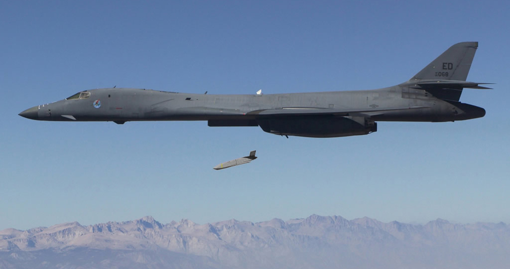 image of plane dropping missile